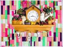 Clock and green pink wood pieces vertical Royalty Free Stock Image