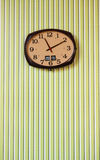 Clock on the green wall. The Clock on the green wall Stock Images