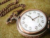 clock guld- gammalt Arkivfoton
