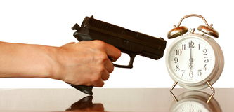 Clock and gun Stock Photo