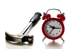 Clock and and hammer. A clock and and a hammer, the concept of nuisance that causes the alarm clock in the morning Stock Photos