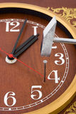 Clock, hammer and nail Royalty Free Stock Image