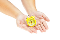 Clock on hand as time management Stock Images