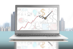 Clock hands with business doodles on notebook screen Stock Image