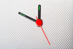 Clock hands on corrugated stainless steel Royalty Free Stock Photo