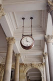 Clock hanging in an archway Royalty Free Stock Photo