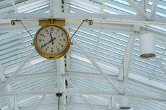 Clock. Hanging from the ceilling stock photography