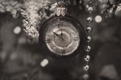 Clock hanging on the Christmas tree branch Royalty Free Stock Photography