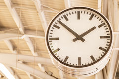 Clock hanging on the pillar Stock Images