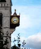 A clock hanging from the side of The Old Bailey stock images
