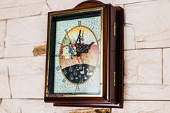 Clock hanging on stone wall. Wall clock hanging on the white stone wall Stock Photos