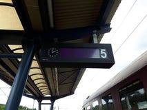 Clock. A hanging clock at a train station Stock Photo