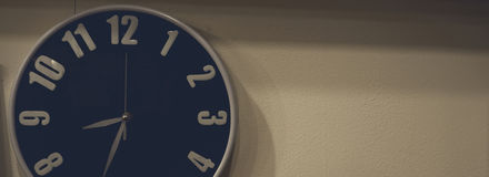 Clock hanging on the wall in the darkness. Clock hanging on the wall in the darkness in darkness room Stock Photos