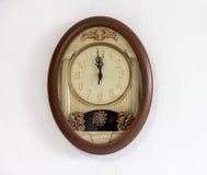 Clock hanging at the wall Royalty Free Stock Photo