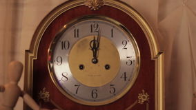 Clock hanging on the wall stock footage