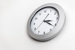 Clock hanging on wall Stock Images