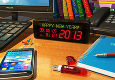 Clock with Happy New Year! message on table. Creative New Year 2013 concept: macro view of digital alarm clock with Happy New Year! message on table among other Royalty Free Stock Photos