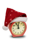 Clock in the hat of Santa Stock Images