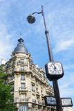 Clock and haussmann architecture in bercy bo Royalty Free Stock Images
