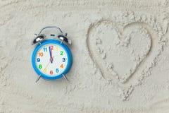 Clock and heart shape symbol Royalty Free Stock Image