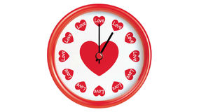 Clock with hearts stock footage