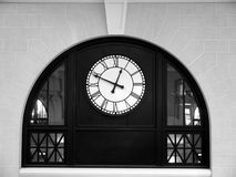 Clock: historic train station arch - h. Clock in historic train station arch in Worcester, Massachusetts - horizontal format, black and white Stock Photos