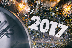 Clock Hits Midnight New Year's 2017 Background. Gritty images featuring '2017' with decorations, confetti, and more. Space for copy royalty free stock images