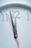 Clock hitting 12 O'clock Stock Photography