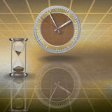 Clock and hourglass on brown Royalty Free Stock Photos