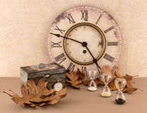 Clock, Hourglasses, Wristwatch, and Pocketwatch with Autumn Leaves Stock Image