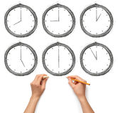 Clock with human hands Royalty Free Stock Photos