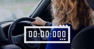 Clock icon against woman in the car Royalty Free Stock Photography