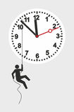 Clock. Illustration of a figure trying to stop the march of time Royalty Free Stock Images