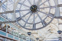 The clock inside of Stephen`s Green shopping centre in Dublin. DUBLIN, IRELAND - February 17th, 2018: the clock inside of Stephen`s Green shopping centre in Royalty Free Stock Photos