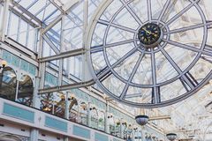 The clock inside of Stephen`s Green shopping centre in Dublin. DUBLIN, IRELAND - February 17th, 2018: the clock inside of Stephen`s Green shopping centre in Royalty Free Stock Photography