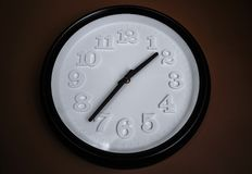 Decorative black and white wall clock stock image