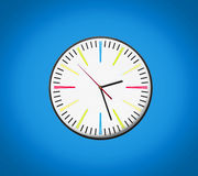 Clock isolated on blue background Royalty Free Stock Photos