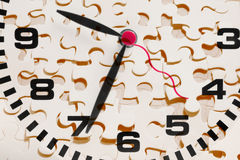Clock and Jigsaw Puzzle Pieces Royalty Free Stock Photo