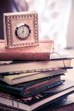 Clock and journals Royalty Free Stock Photography