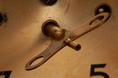 Clock key. Antique clock key to wind up the clock Stock Photo