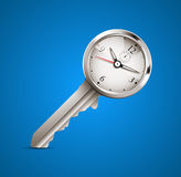 Clock and key as time management Stock Photography