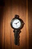 Clock key Stock Photos