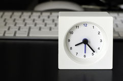Clock, keyboard, business table Royalty Free Stock Image
