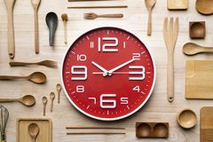 Clock and kitchen utensils for cooking Stock Images