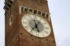 Clock on Lamberti Tower in Verona, Italy Stock Photos