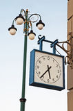Clock and lamp Stock Images