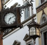 Clock and lamp Stock Photography