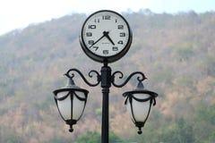 Clock & lamp post Royalty Free Stock Images