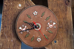 Clock from leather with decorations Stock Photo