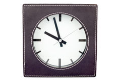 Clock in leather frame Stock Image
